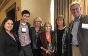 group shot with Laurie Odell holding award