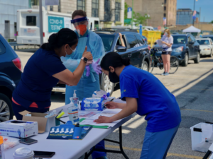 Nurse and medical assistants handling COVID testing in Uptown Chicago