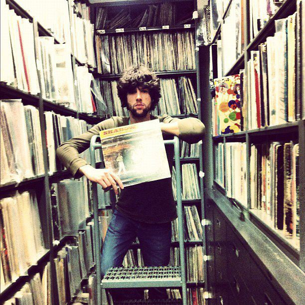 DJGac in a record library holding an album