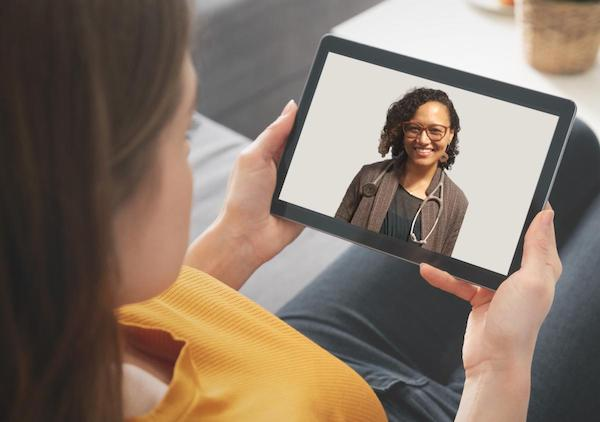 Dr. Sonia Oyola on a tablet - telehealth video visit