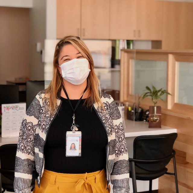 Care Specialist stands in HHC-Lakeview new location lobby